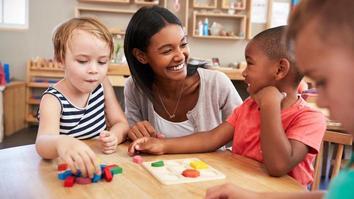 Early years teacher teaching kindergarten children