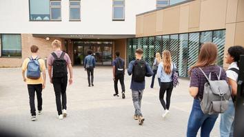 Students walking into university building