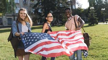 Students holding American flag on campus