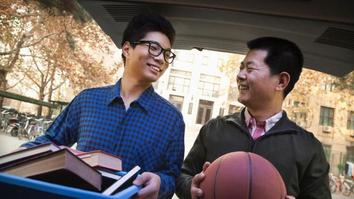 Father and Son unpacking car in front of university