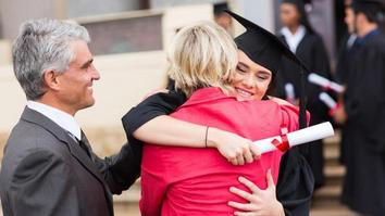Happy student hugging her mother after graduation