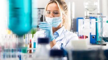 Female scientist preparing laboratory equipment for tests