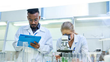 Two science students doing research in a lab