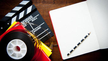 Open notebook and pencil for a creative screen writer with film reel, more notebooks and a clapperboard