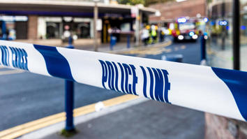Blue and white police cordon ribbon in a London street