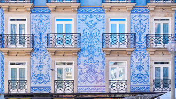 Traditional historic facade in Porto decorated with blue tiles